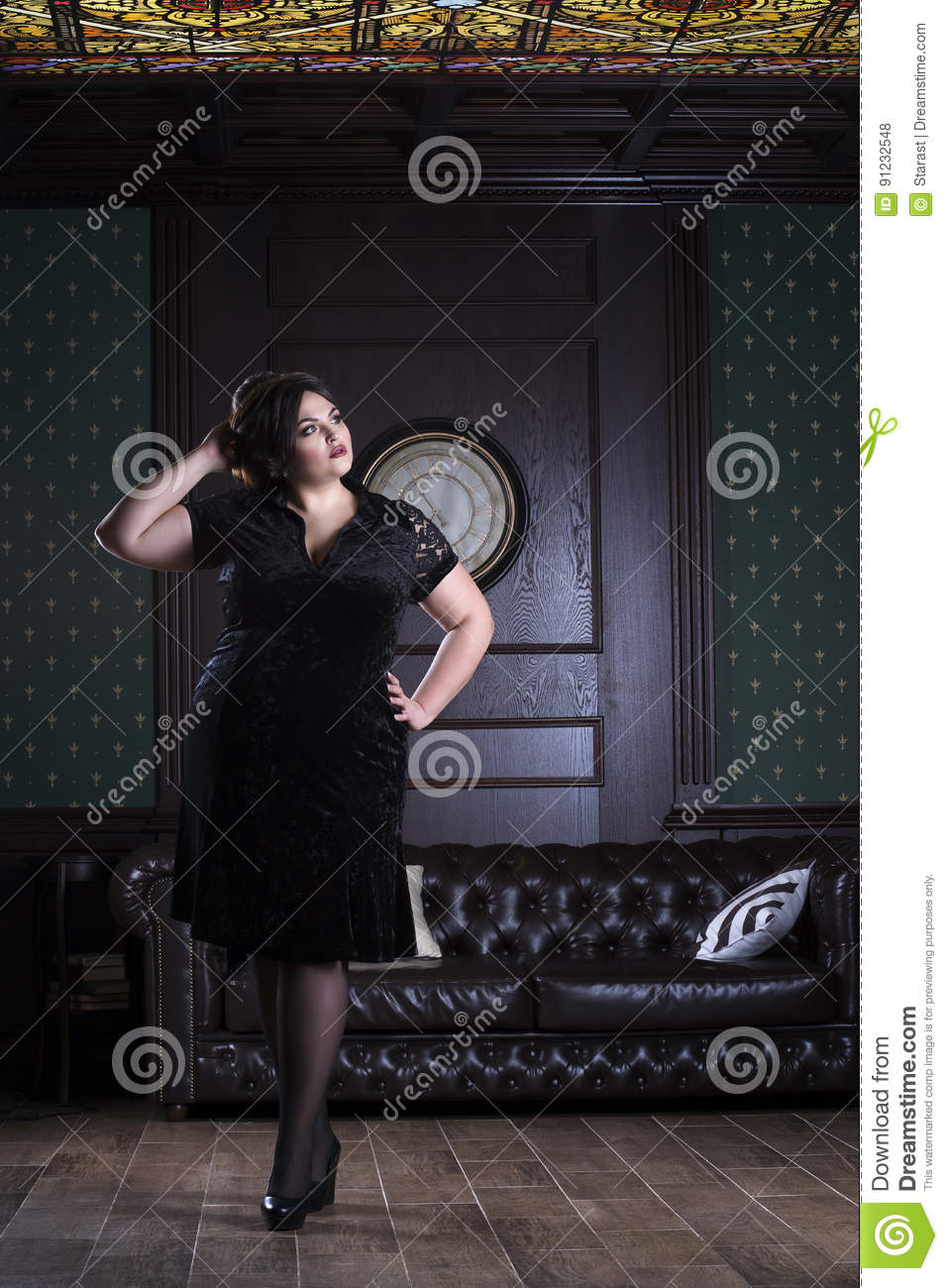 Plus size fashion model in black evening dress, fat woman on luxury interior, overweight female body, full length portrait