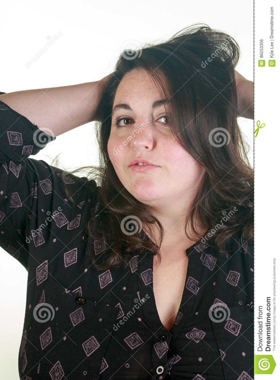 plus size woman posing in the studio stock photo - image of light