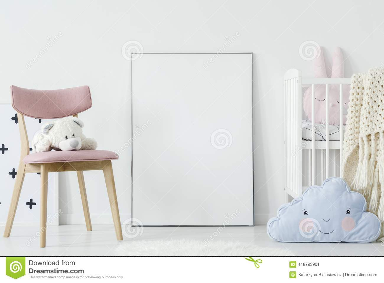 Plush toy on pink chair and blue pillow in child`s room interior