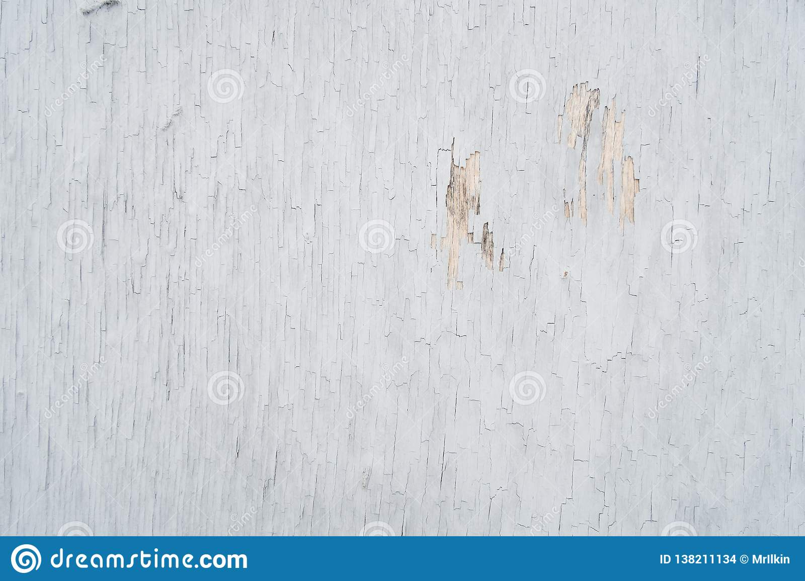 Plywood covered with old peeling paint, for background or texture.