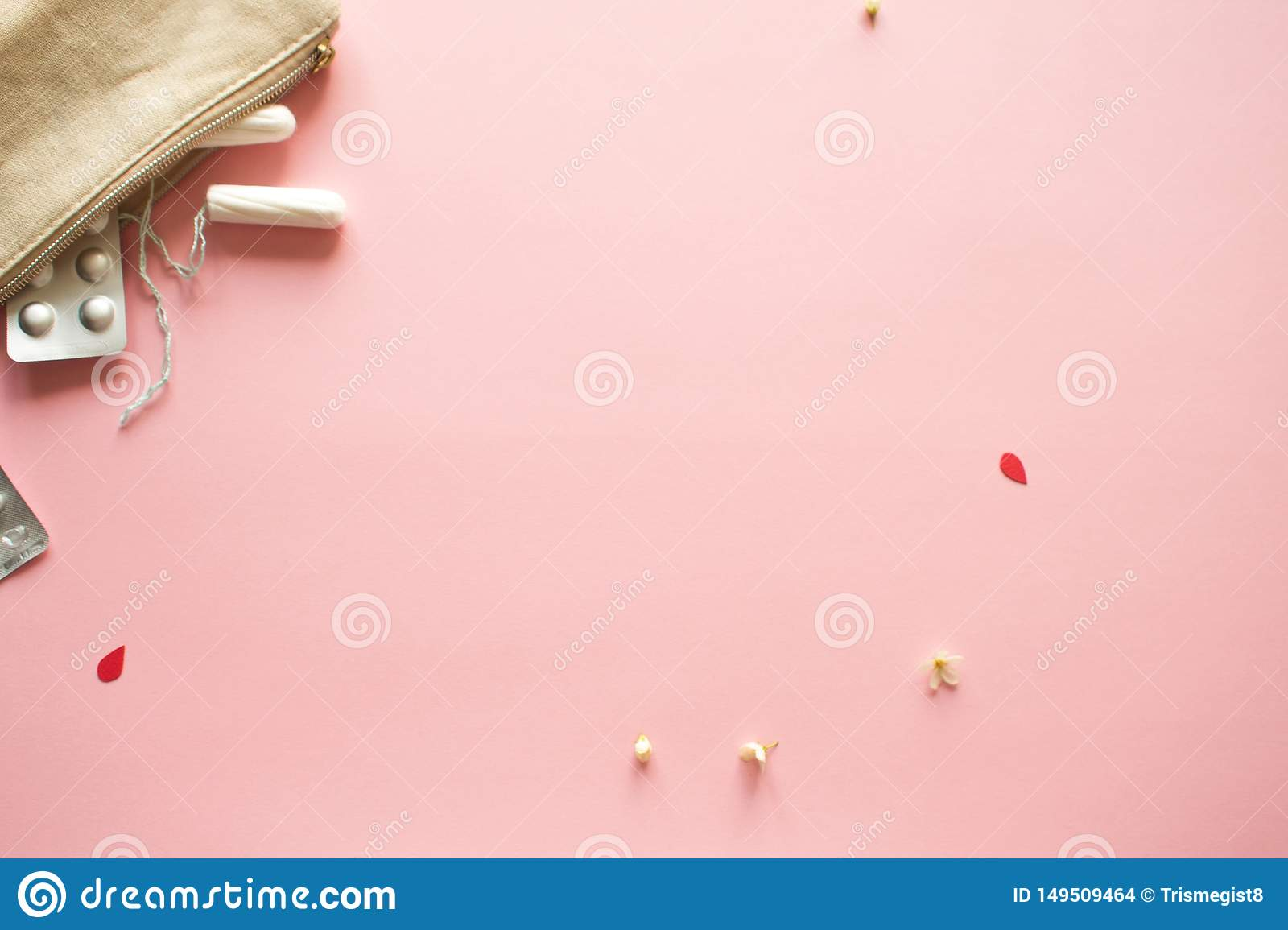 PMS and the critical days concept. Pain pills and personal care products, pink background