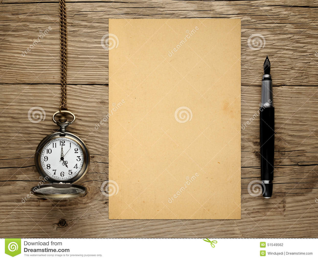 Pocket watch, fountain pen and old paper
