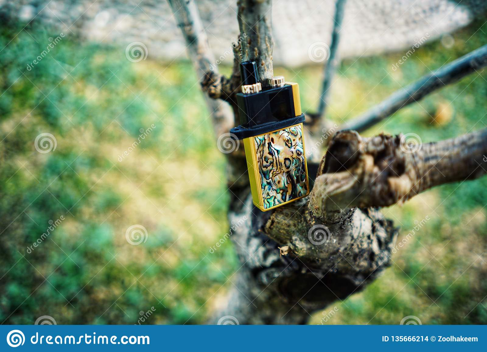 New Vape pod system for quitting smoking habit alternative on small tree branches