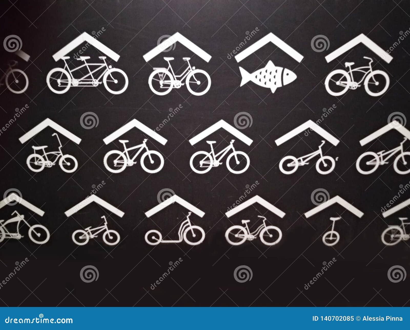 Podpisuje wewnątrz czarnego tło z białymi rysunkami stylizowany symboliczny przedstawicielstwo Holland świeża ryba i bicykle