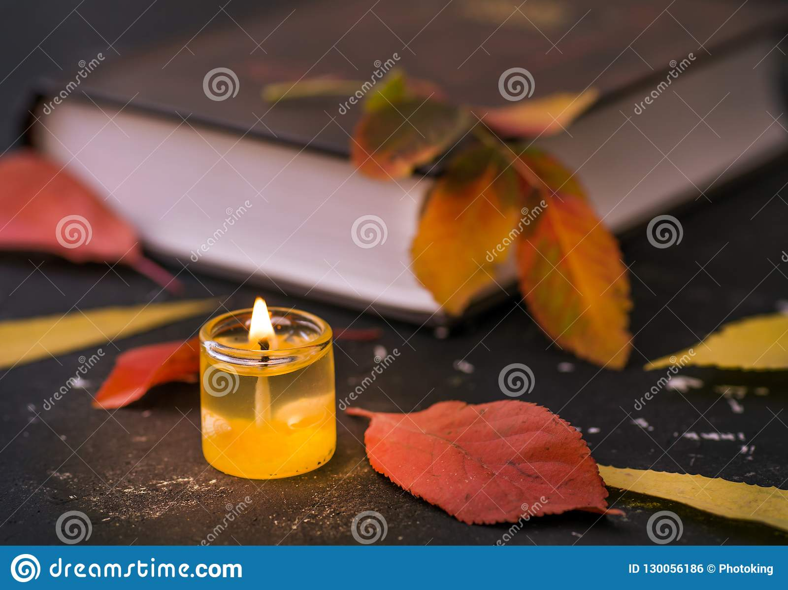 Poetry book with candle