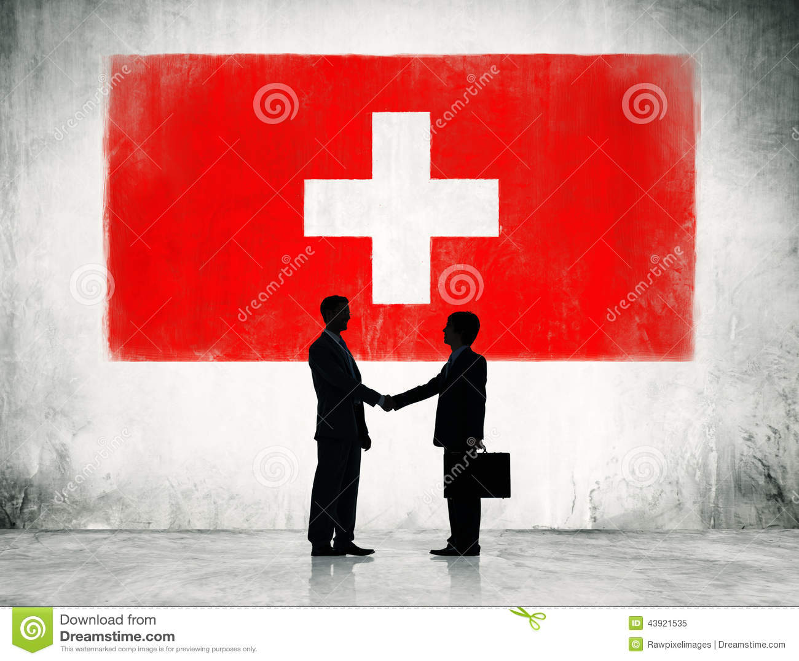 Poignée de main d hommes d affaires avec le drapeau de la Suisse