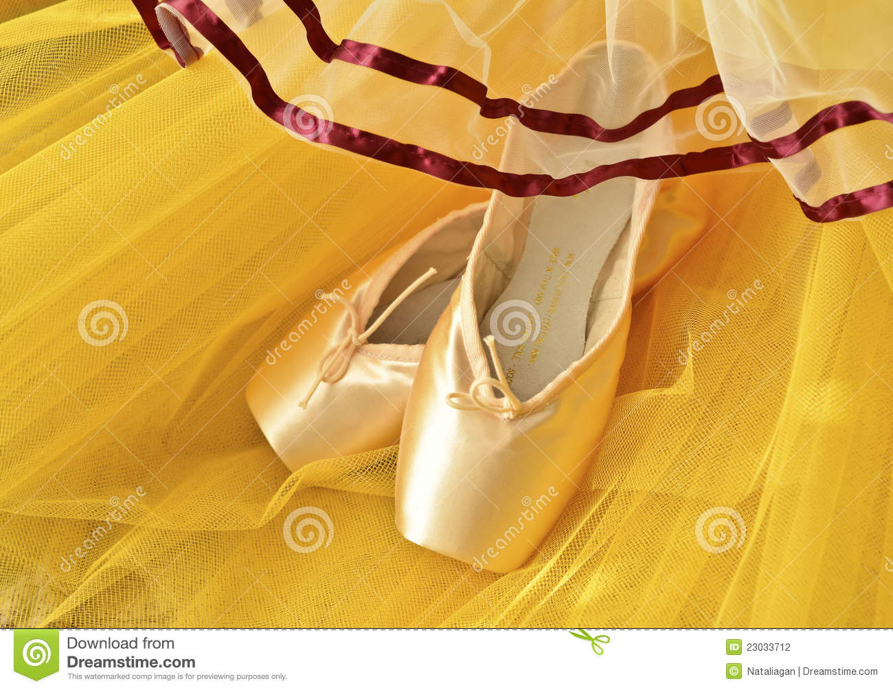 pointe shoes and yellow tutu stock photography image