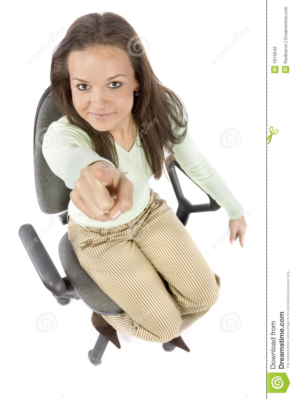 Pointing woman sitting on the office chair - headshot, white