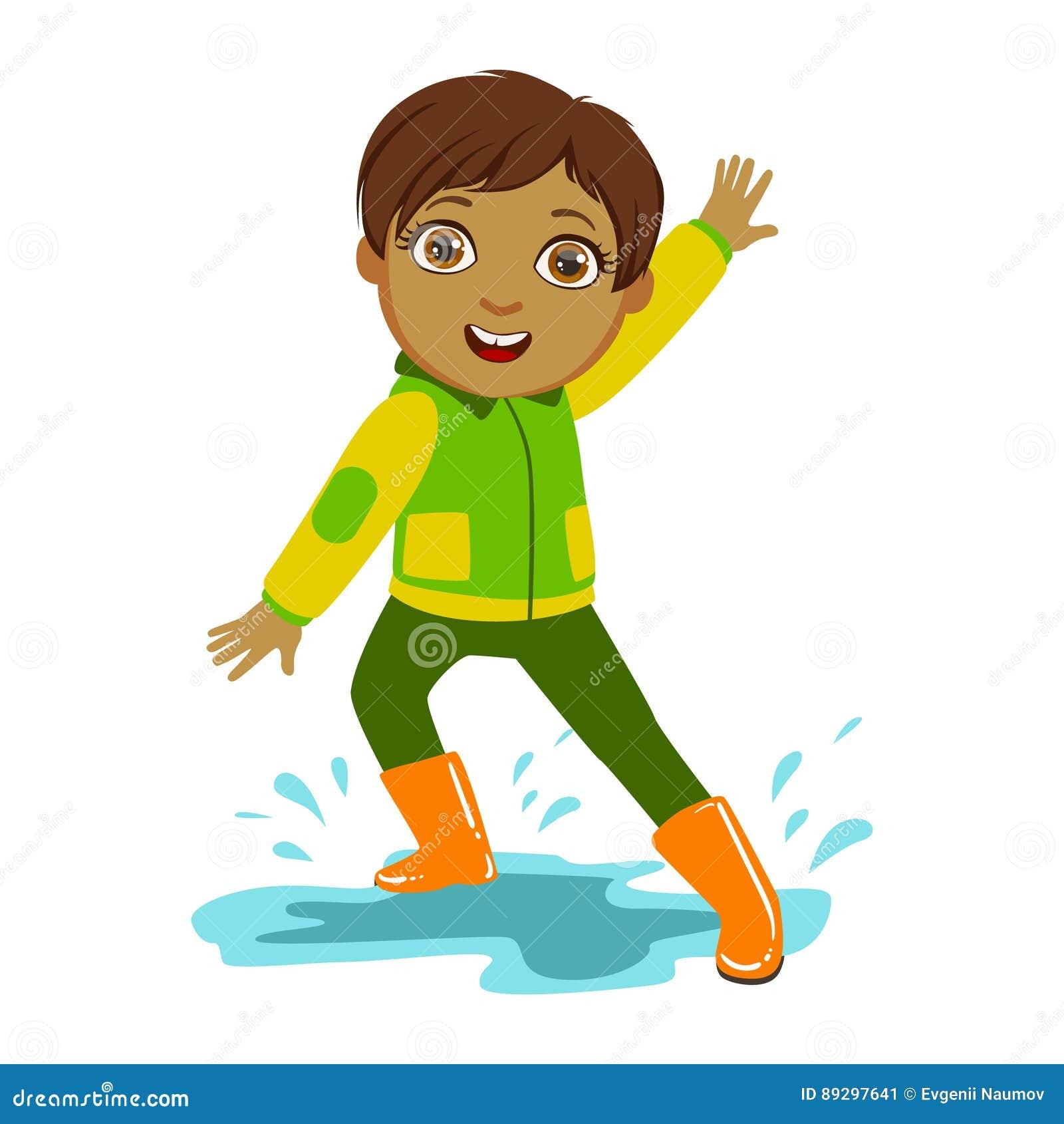 Pojke i grönt och gult omslag, unge i Autumn Clothes In Fall Season Enjoyingn regn och regnigt väder, färgstänk och