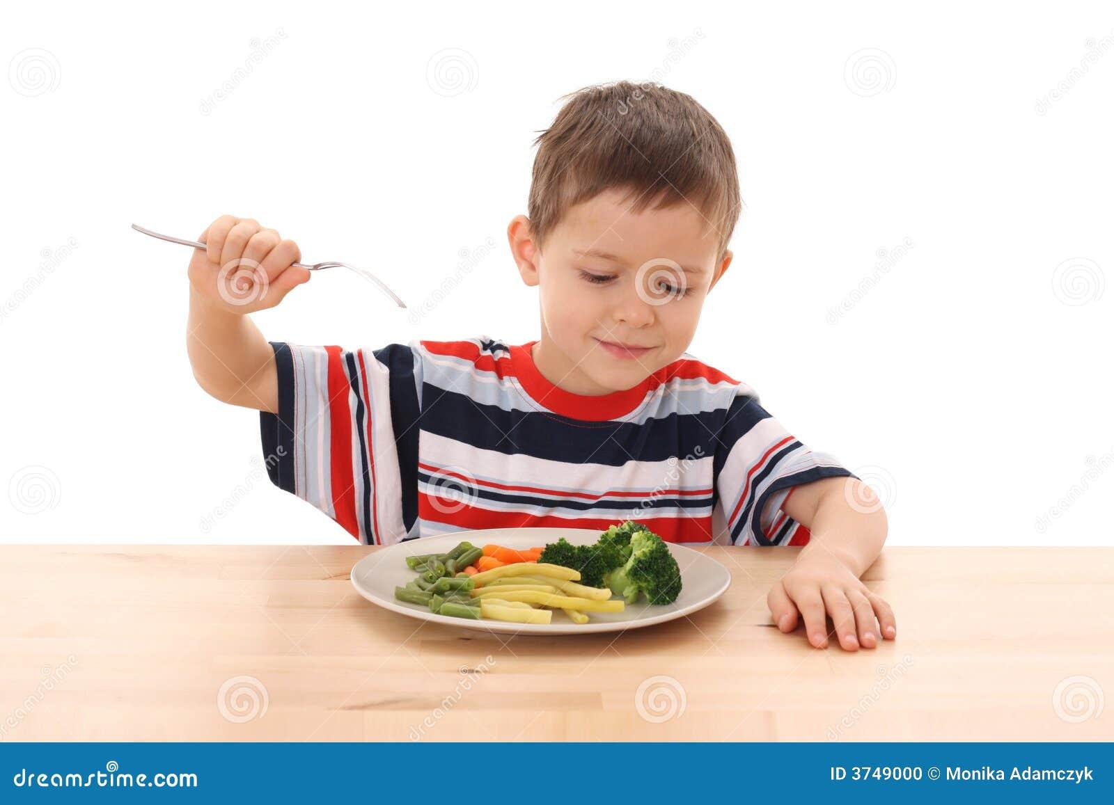 Pojke lagade mat grönsaker