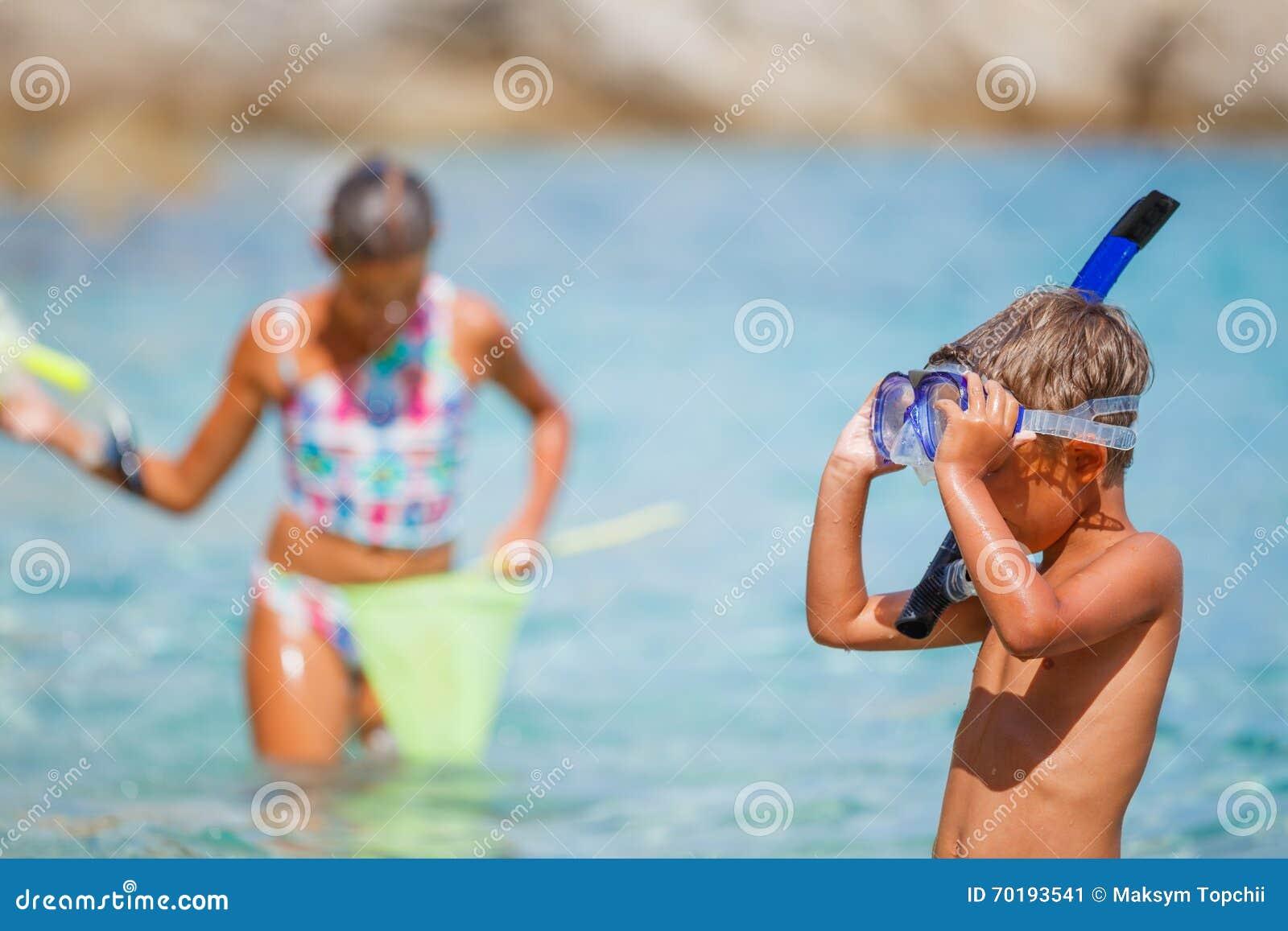 Pojke på stranden