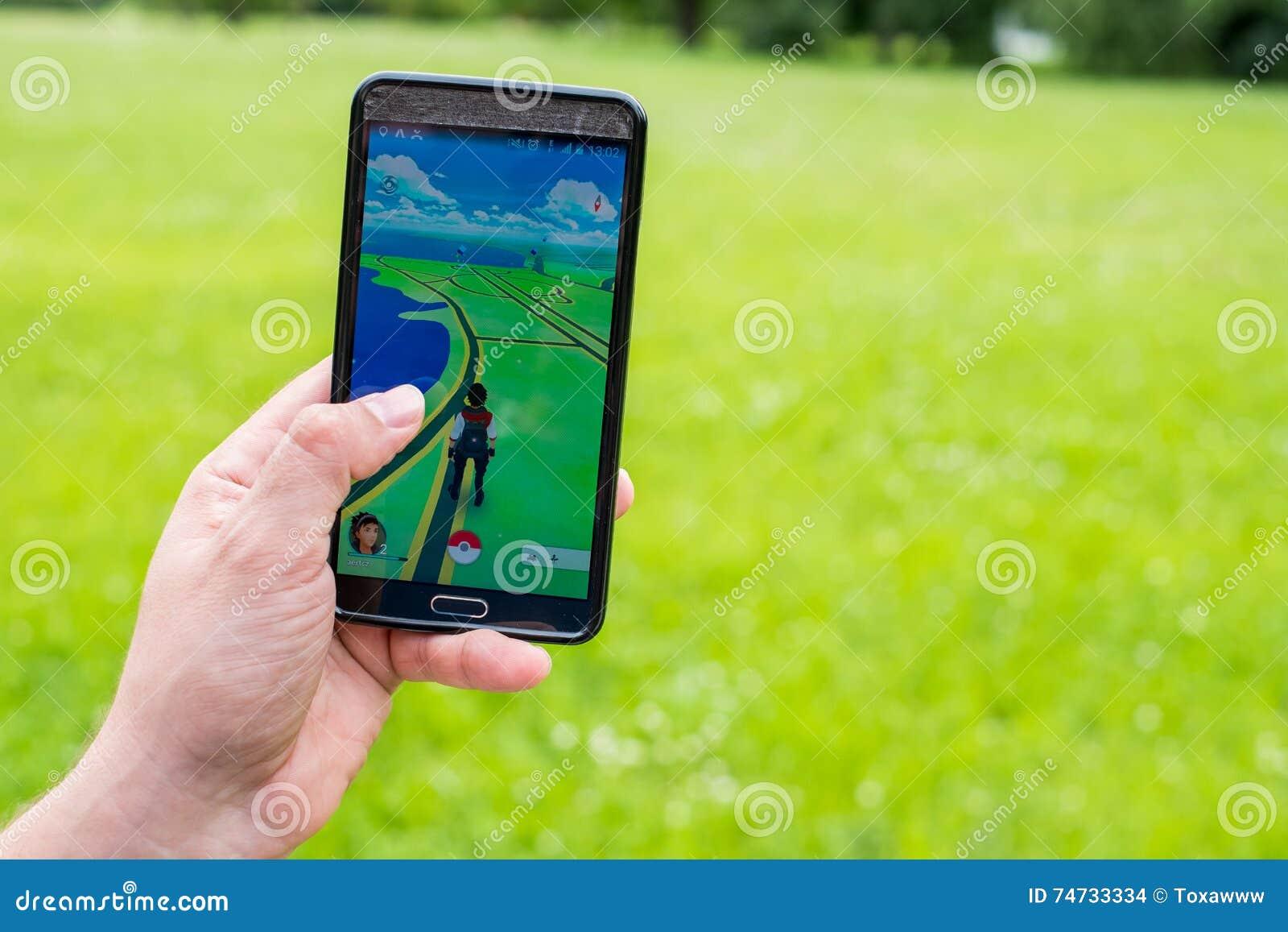 Pokemon Go Application On The Smartphone Editorial Stock