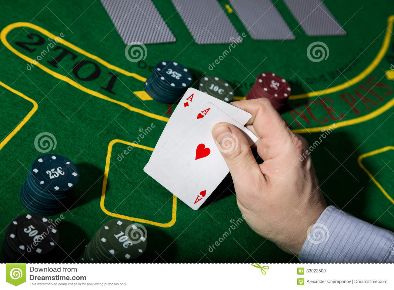 Poker table background - Poker Playing Card On A Green Table Background Man Holding Two Aces