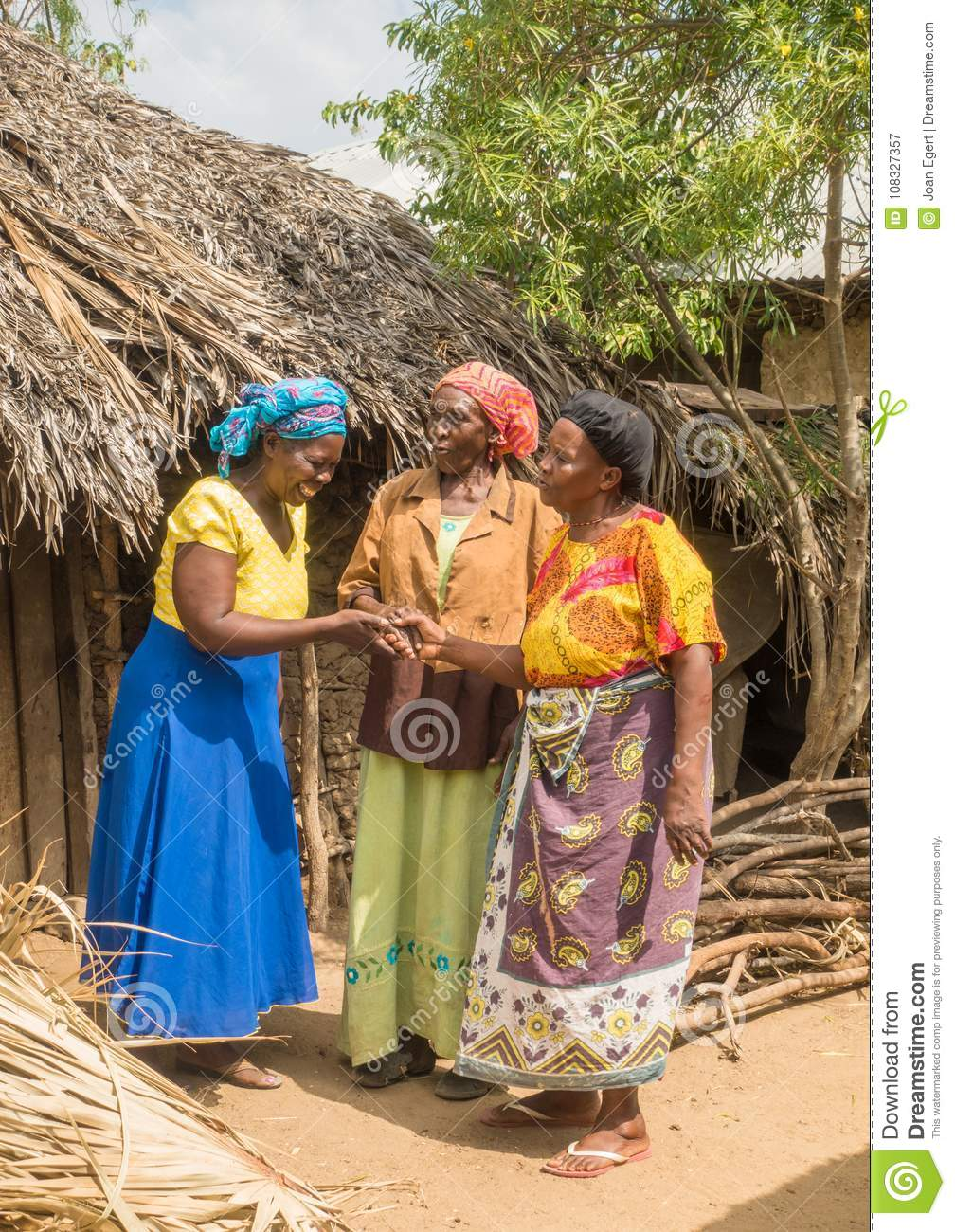 Pokomo women greeting at traditional african homes editorial download pokomo women greeting at traditional african homes editorial photography image of front county m4hsunfo