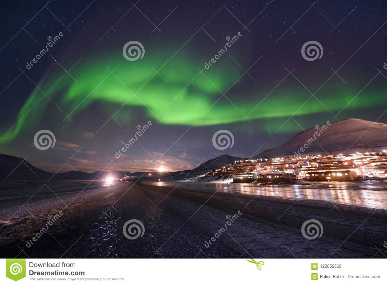 Polar arctic Northern lights aurora borealis sky star in Norway Svalbard in Longyearbyen city travel mountains