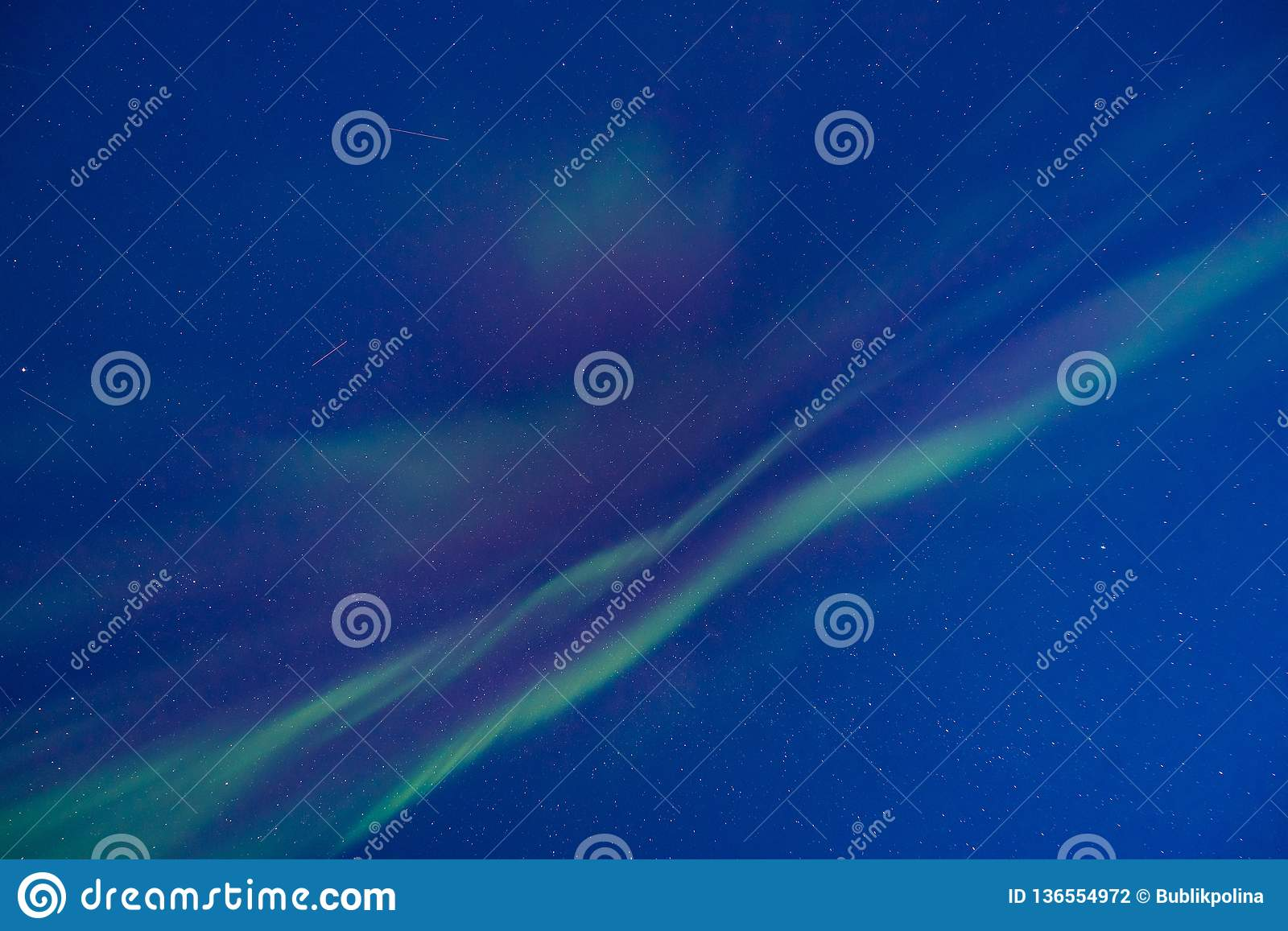 Polar arctic Northern lights aurora borealis sky star in Norway Svalbard in Longyearbyen the moon mountains