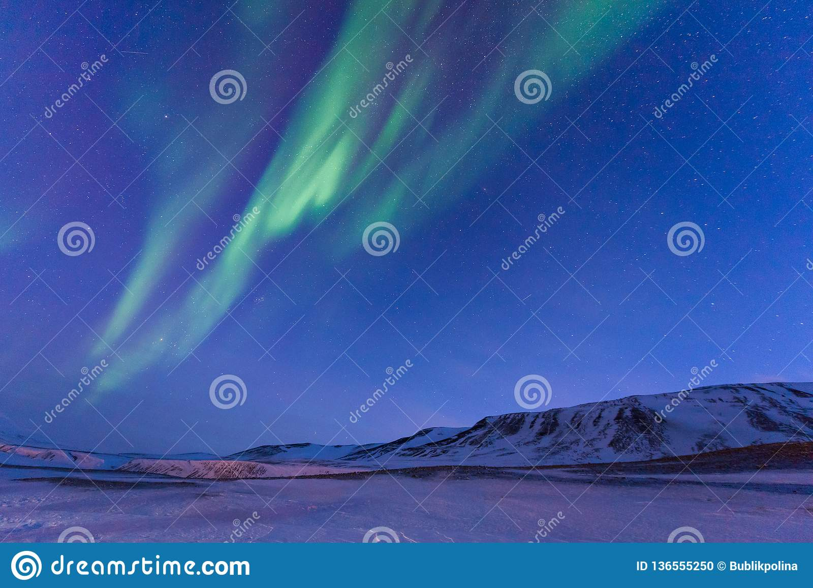 Polar arctic Northern lights aurora borealis sky star in Norway Svalbard in Longyearbyen the moon mountains