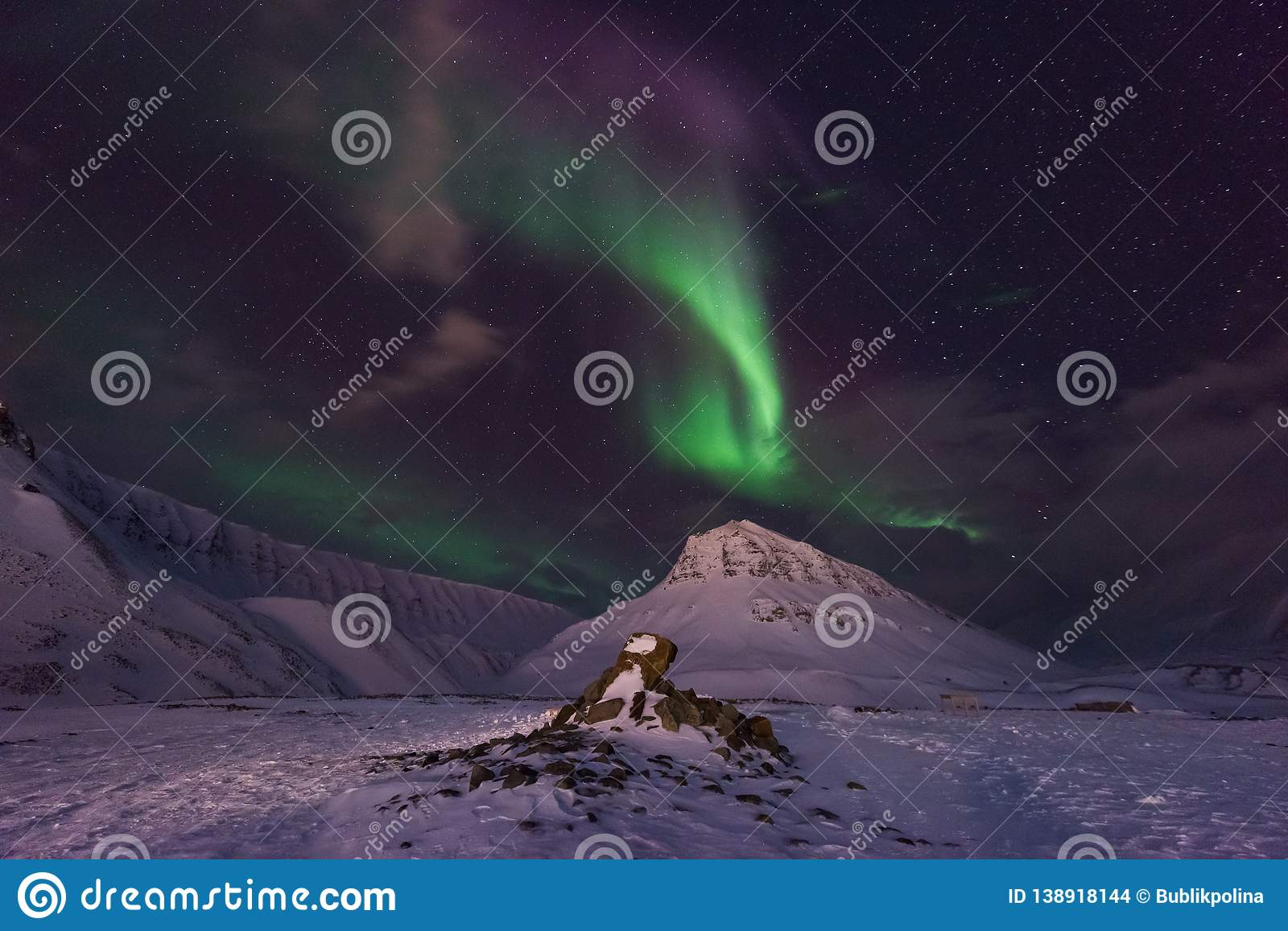 Arctic Northern lights aurora borealis sky star in Norway travel Svalbard in Longyearbyen city the moon mountains