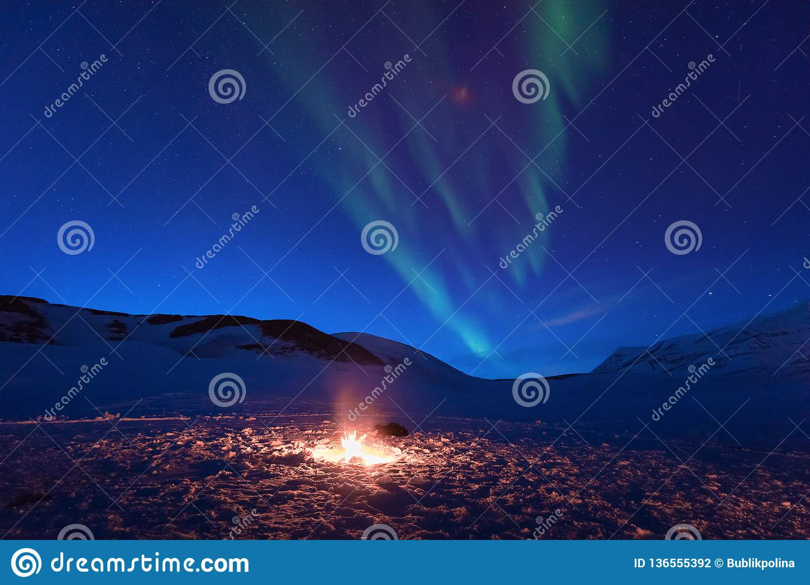 Polar arctic Northern lights aurora snowscooter borealis sky star in Norway Svalbard in Longyearbyen the moon mountains