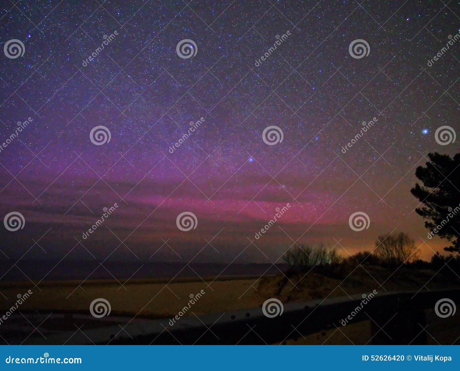 Stars and aurora borealis polar lights