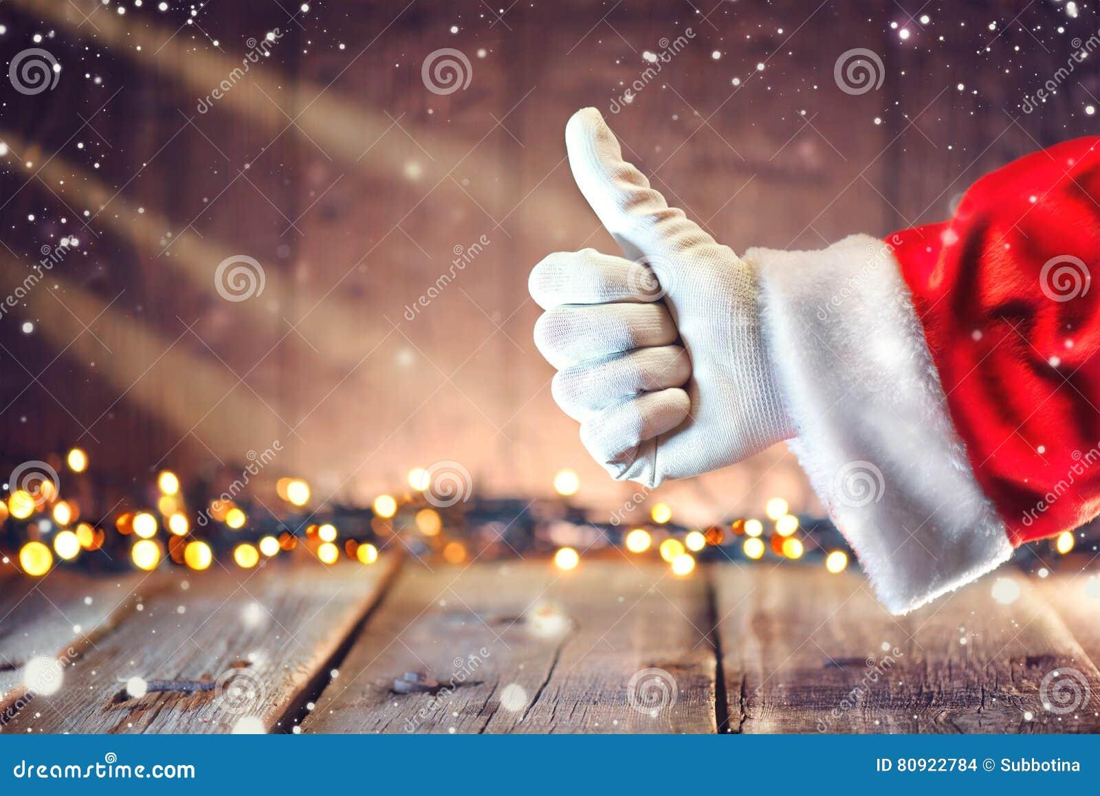 Polegar de Santa Claus acima do gesto sobre o fundo do Natal