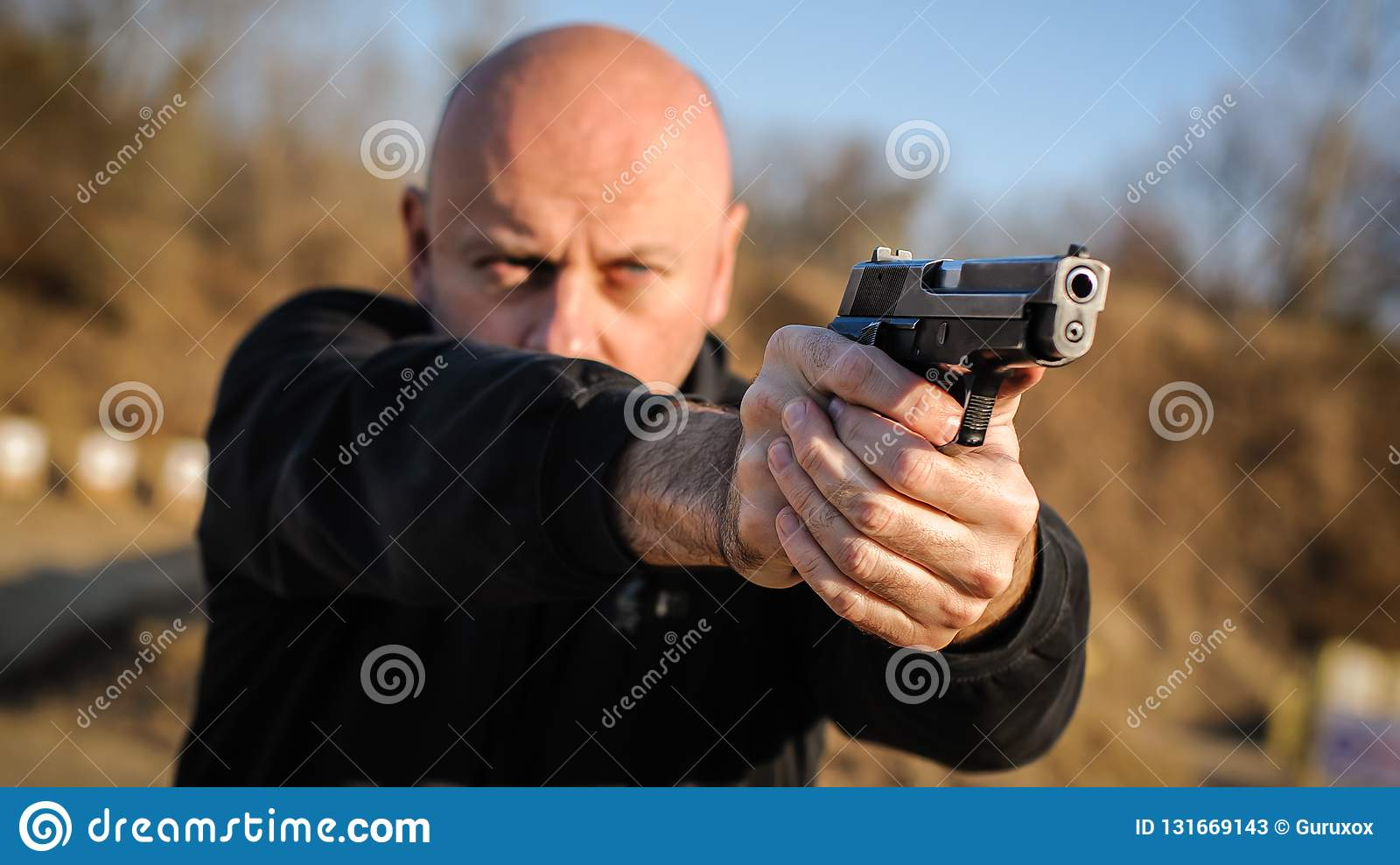 Police agent and bodyguard pointing pistol to protect from attacker