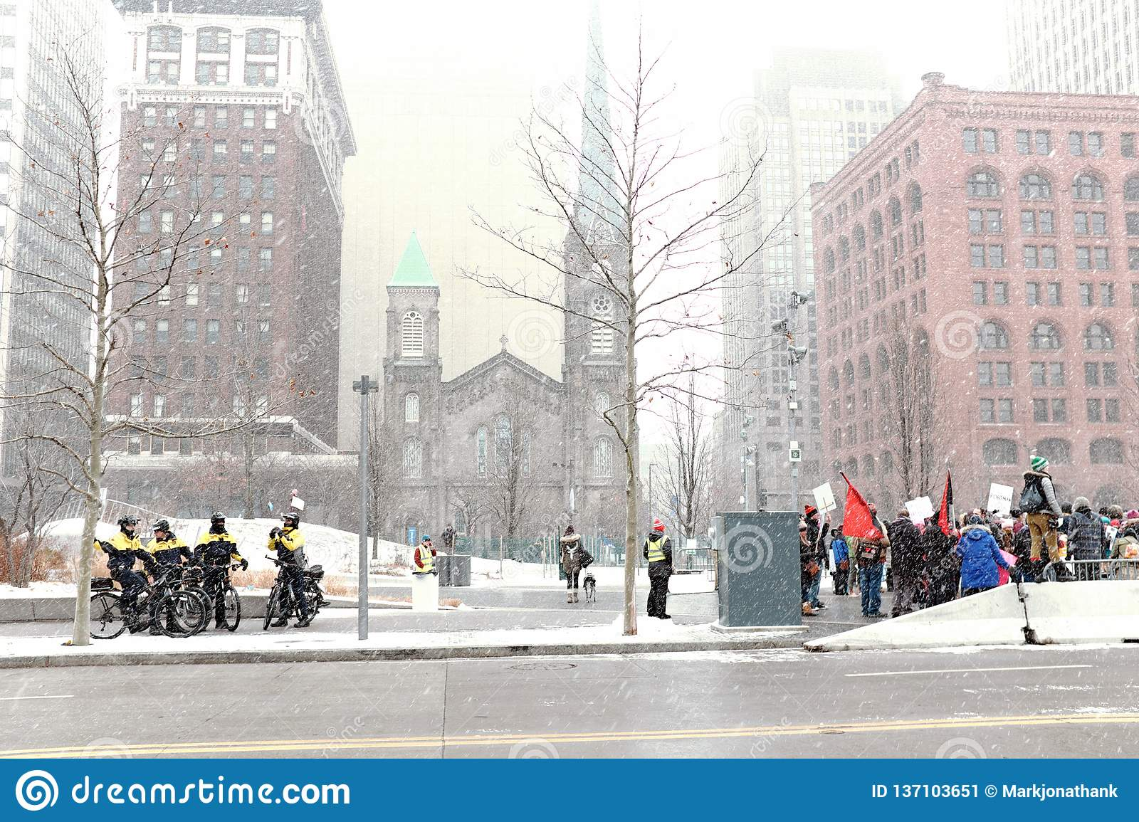 Police on bikes across from the tail end of the 2019 Women`s March during winter snowstorm