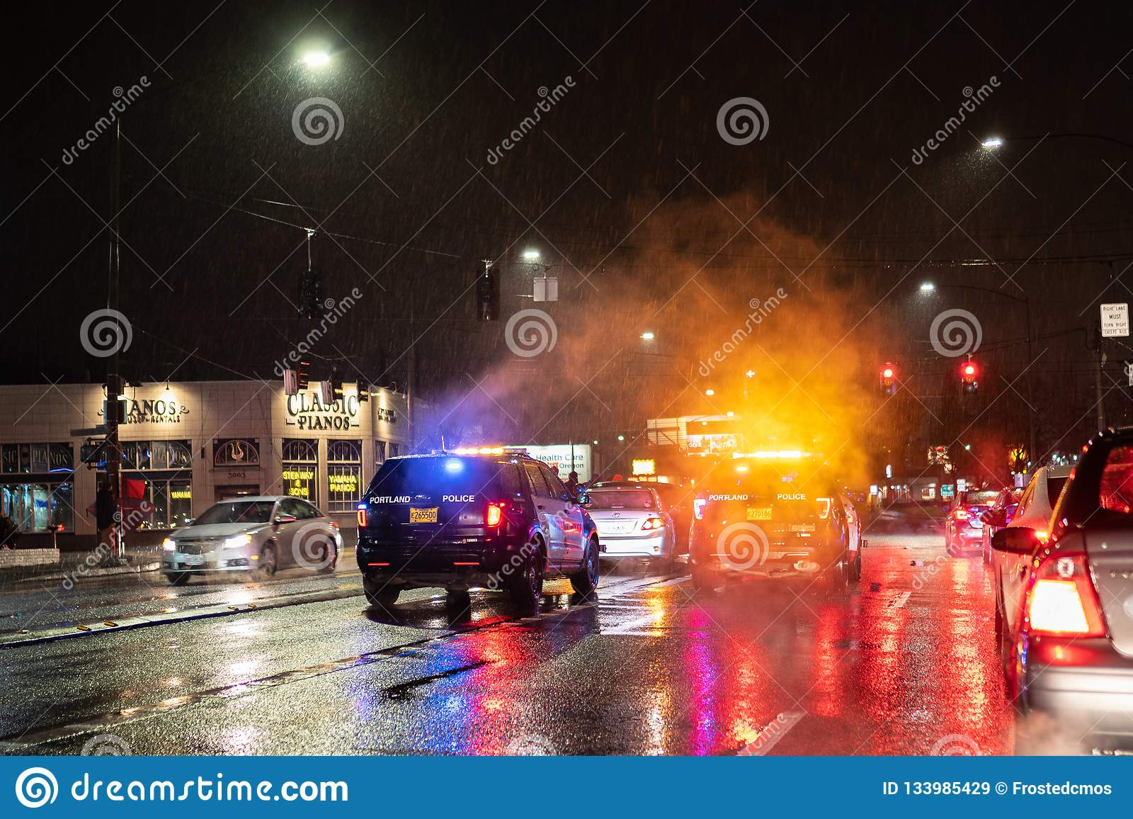 Police At Car Accident Scene At Night During Rain  Editorial