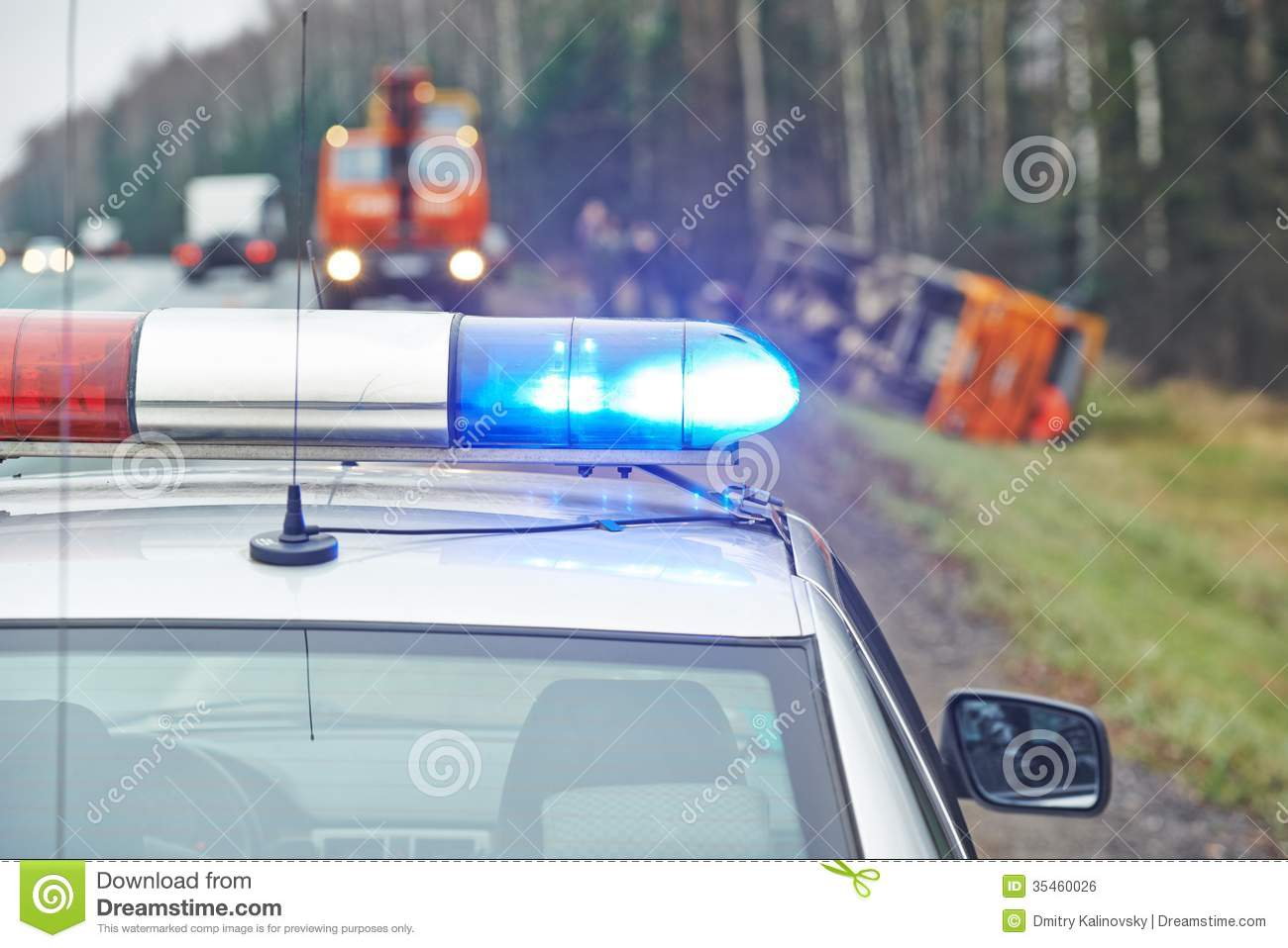 Police car with a flasher at lorry crash