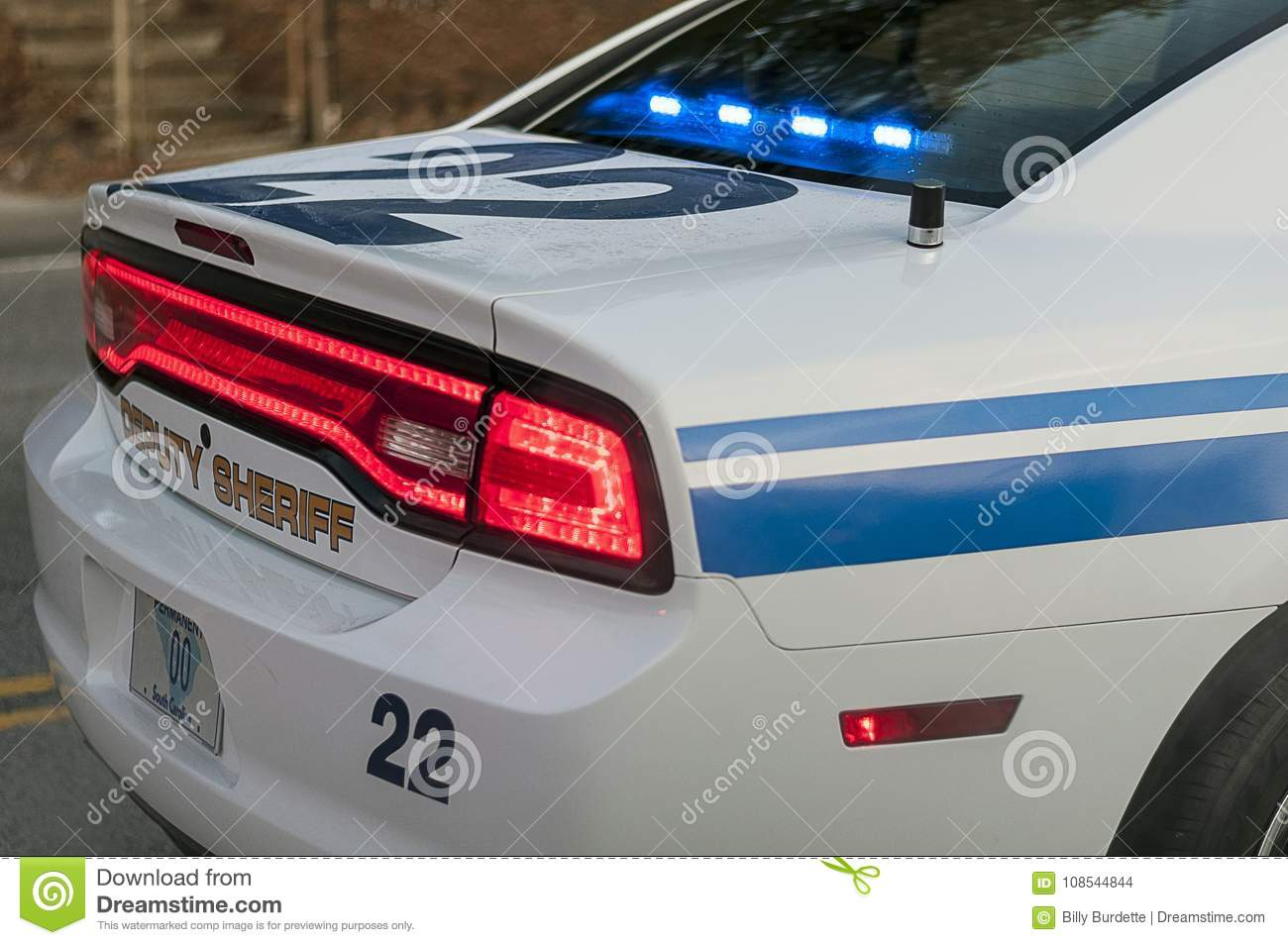 police car with flashing blue lights during traffic stop editorial