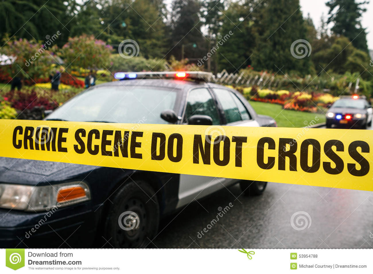 Police cars at crime scene behind taped barrier stock photo image