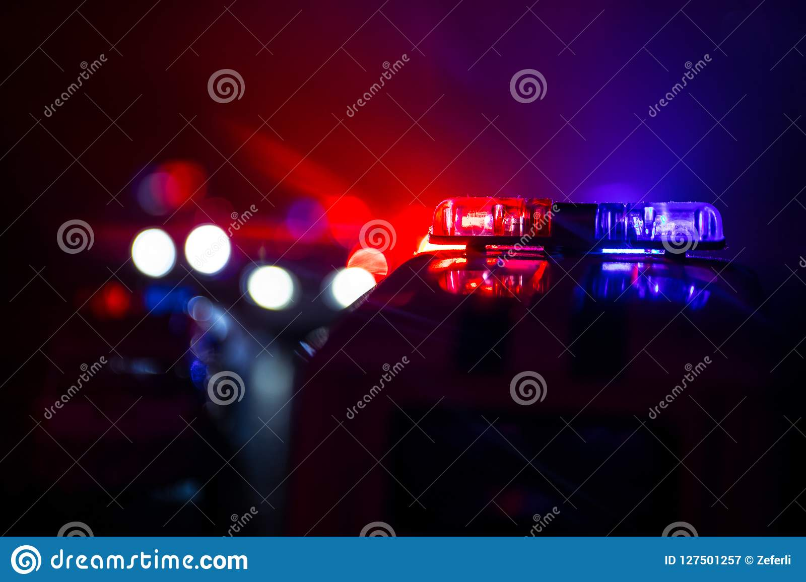 Police Car Chasing A Car At Night With Fog Background  911