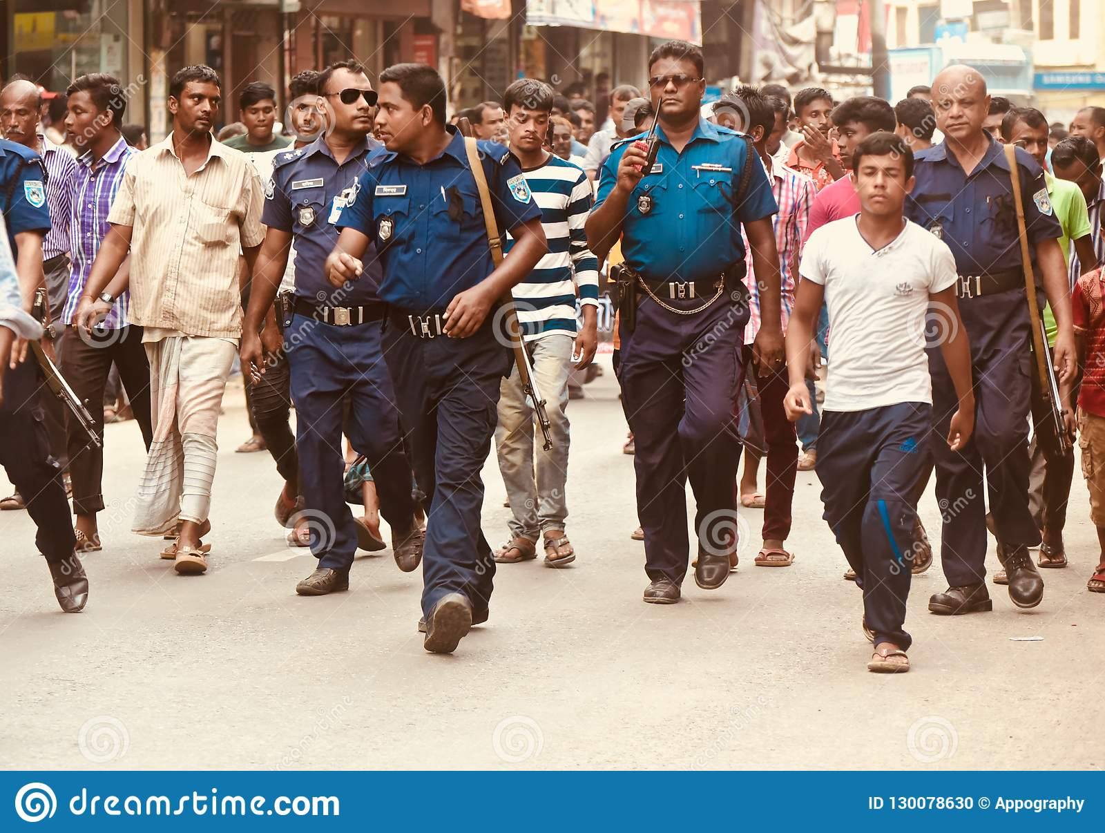 Police force walking in the road in Bangladesh