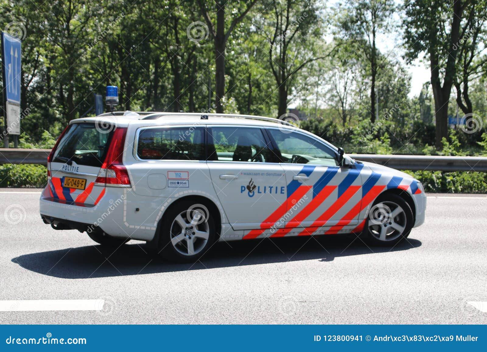 Police of highway patrol in action after collision on Motorway A20 at Nieuwerkerk aan den IJssel in the Netherlands