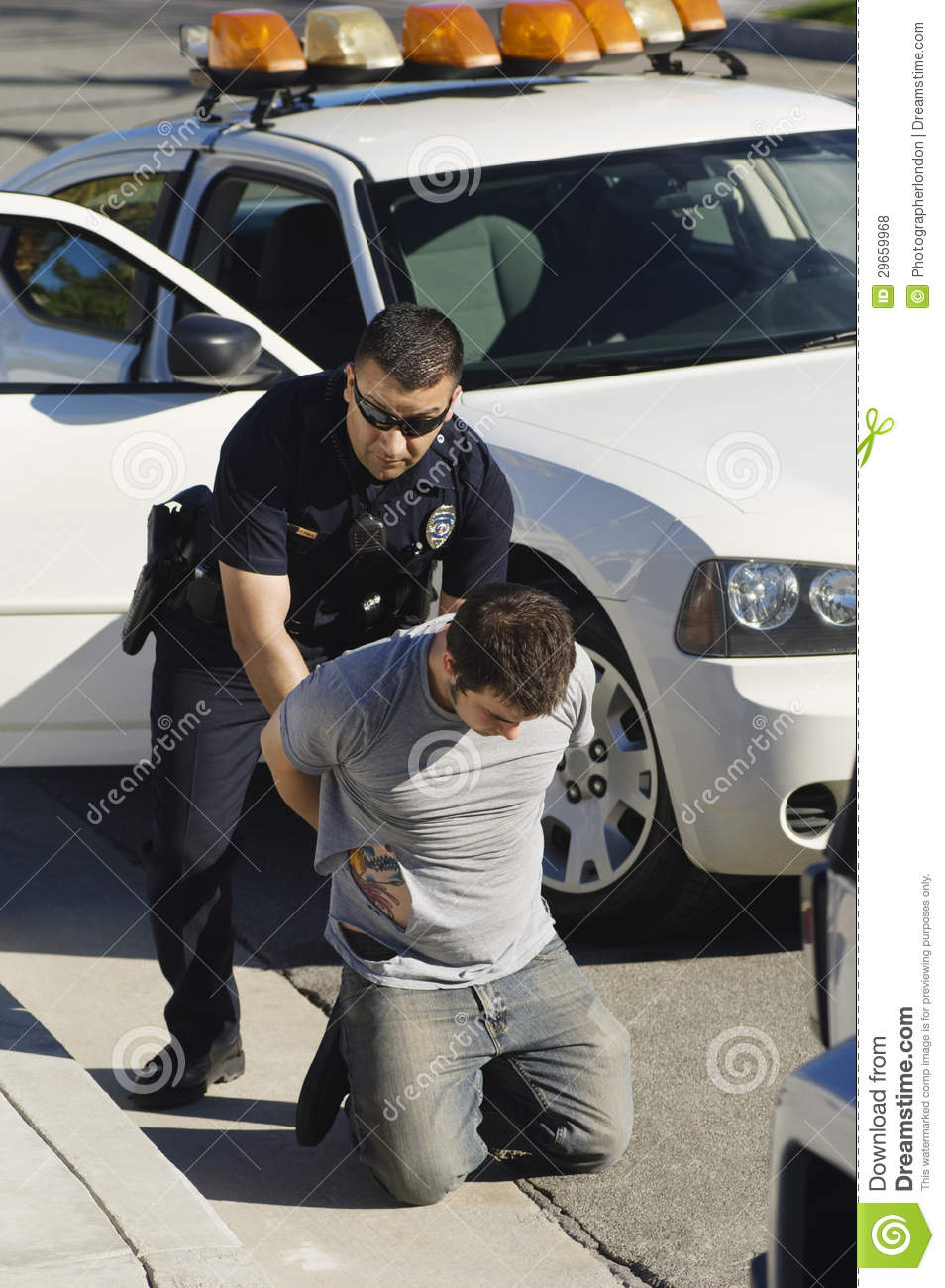Police Officer Arresting Young Man Stock Photo - Image of ...
