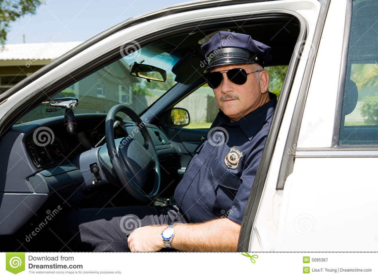 Man Getting Out Of A Cop Car Stock Photo