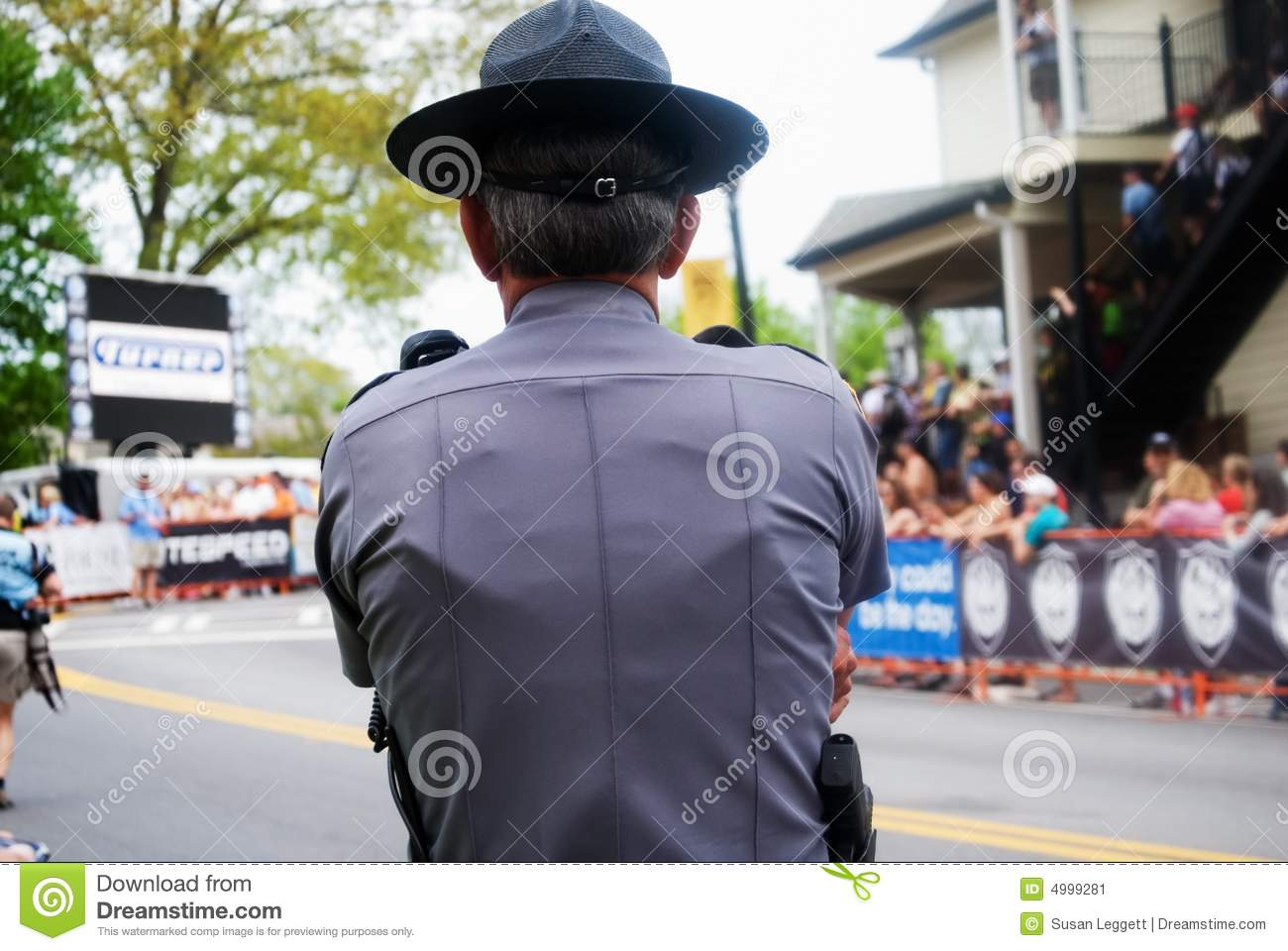 Police officer watching crowd