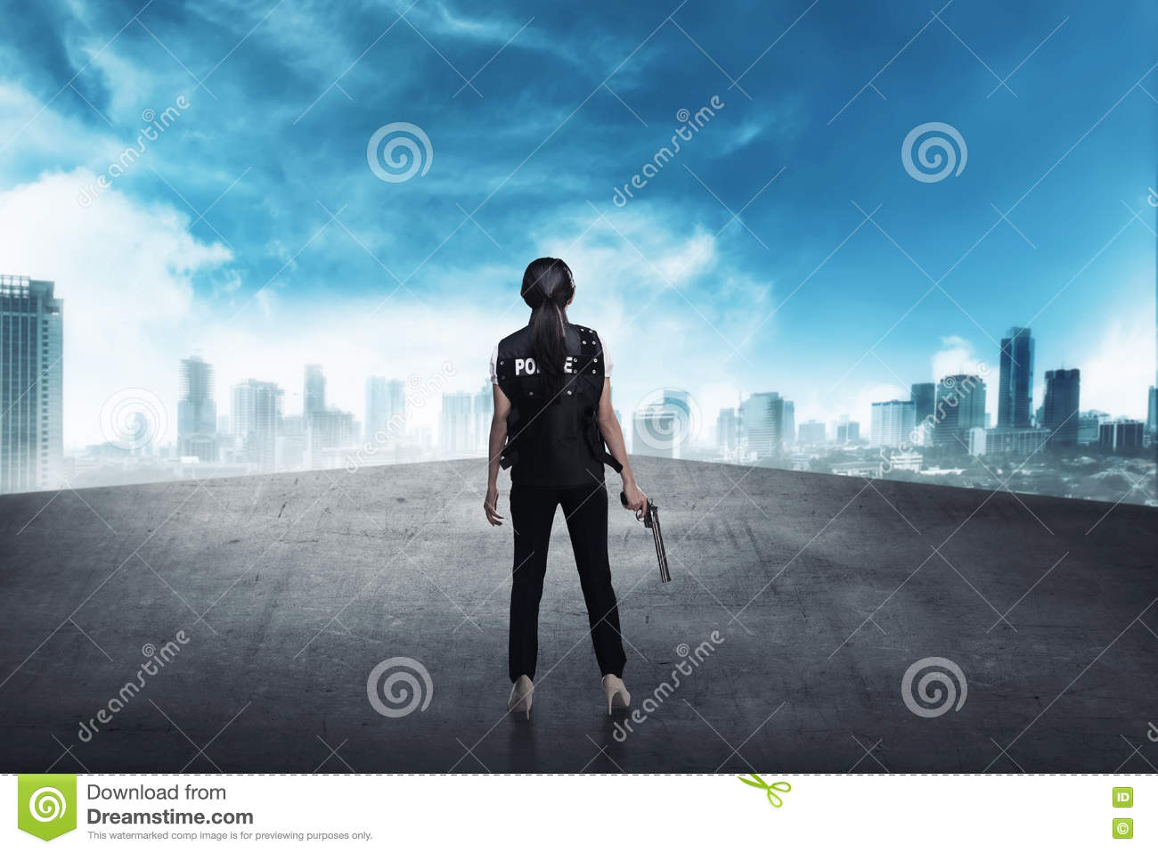 Police woman standing on the building rooftop