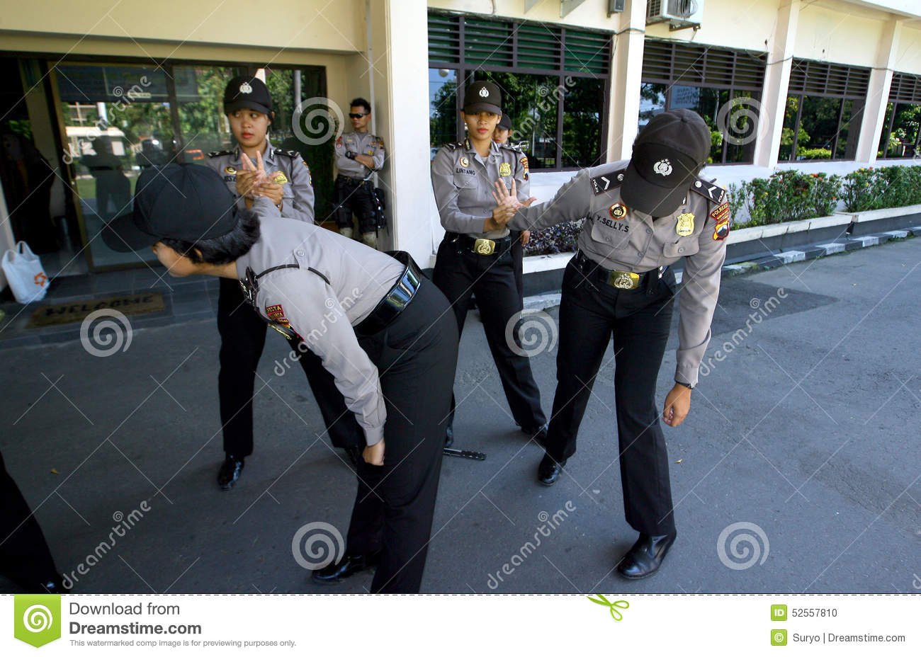 Police woman practicing martial arts at the police station yard in the ...