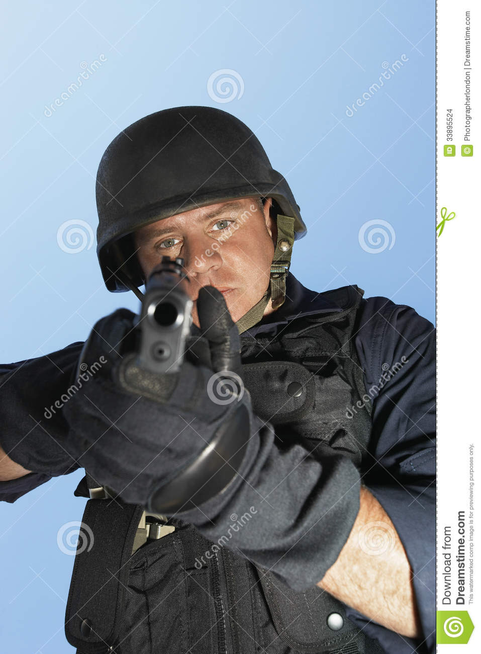 Policeman Aiming Gun Against Blue Sky Stock Images Image