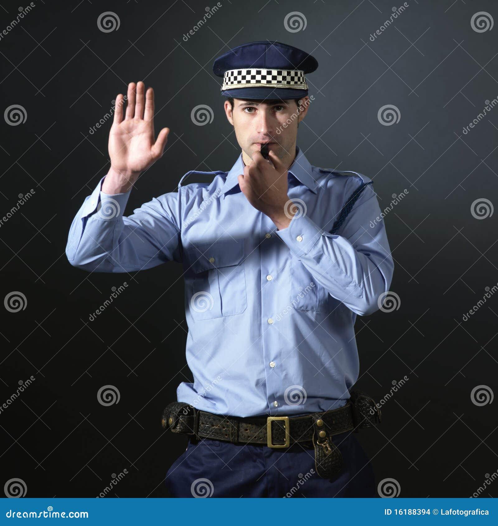 Policeman gesturing to stop.