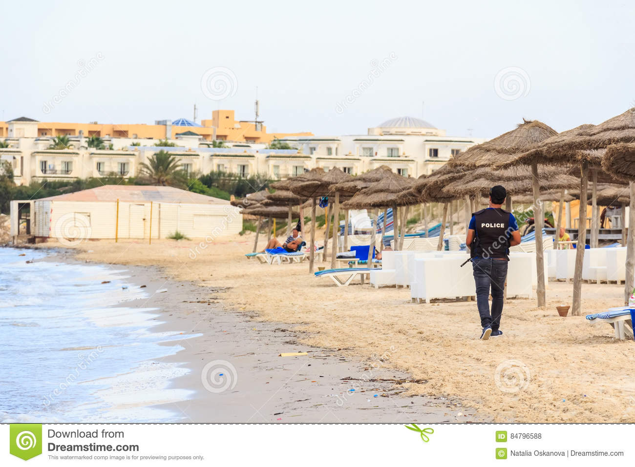 Policeman walks on beach