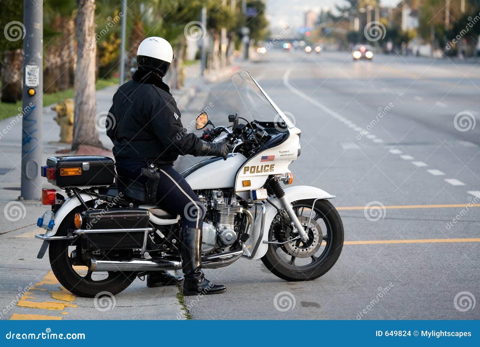 Policja na motocyklu glina