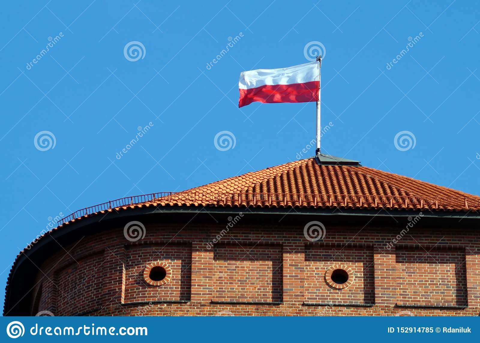 Polish national flag on the top of roof Wawel tower