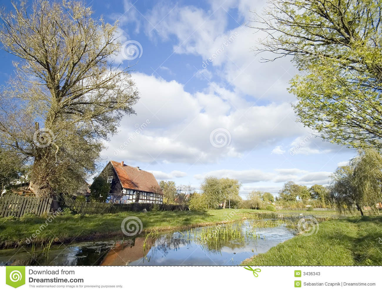 ... Polish retro countryside. Cottage and pond in autumn, sunny weather