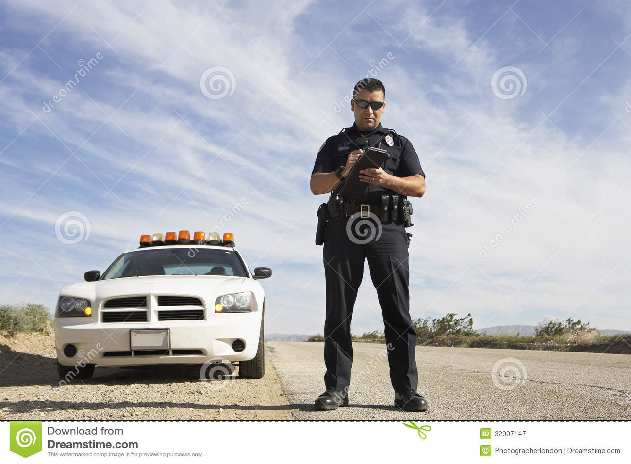 Politieman Taking Notes In Front Of Car
