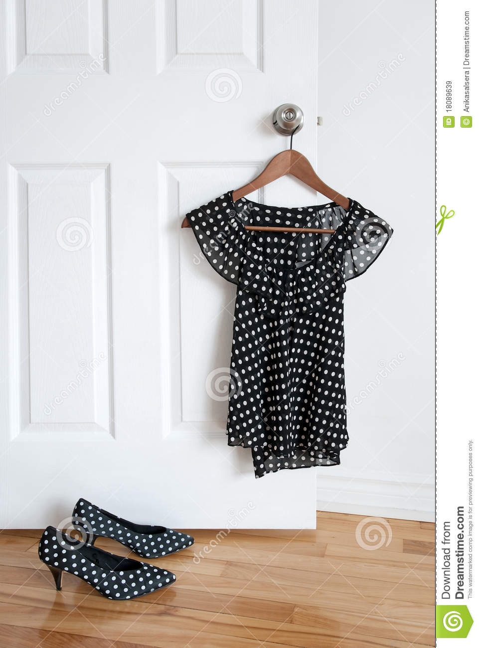 Polka Dot Shoes And Stylish Blouse On A Hanger Royalty