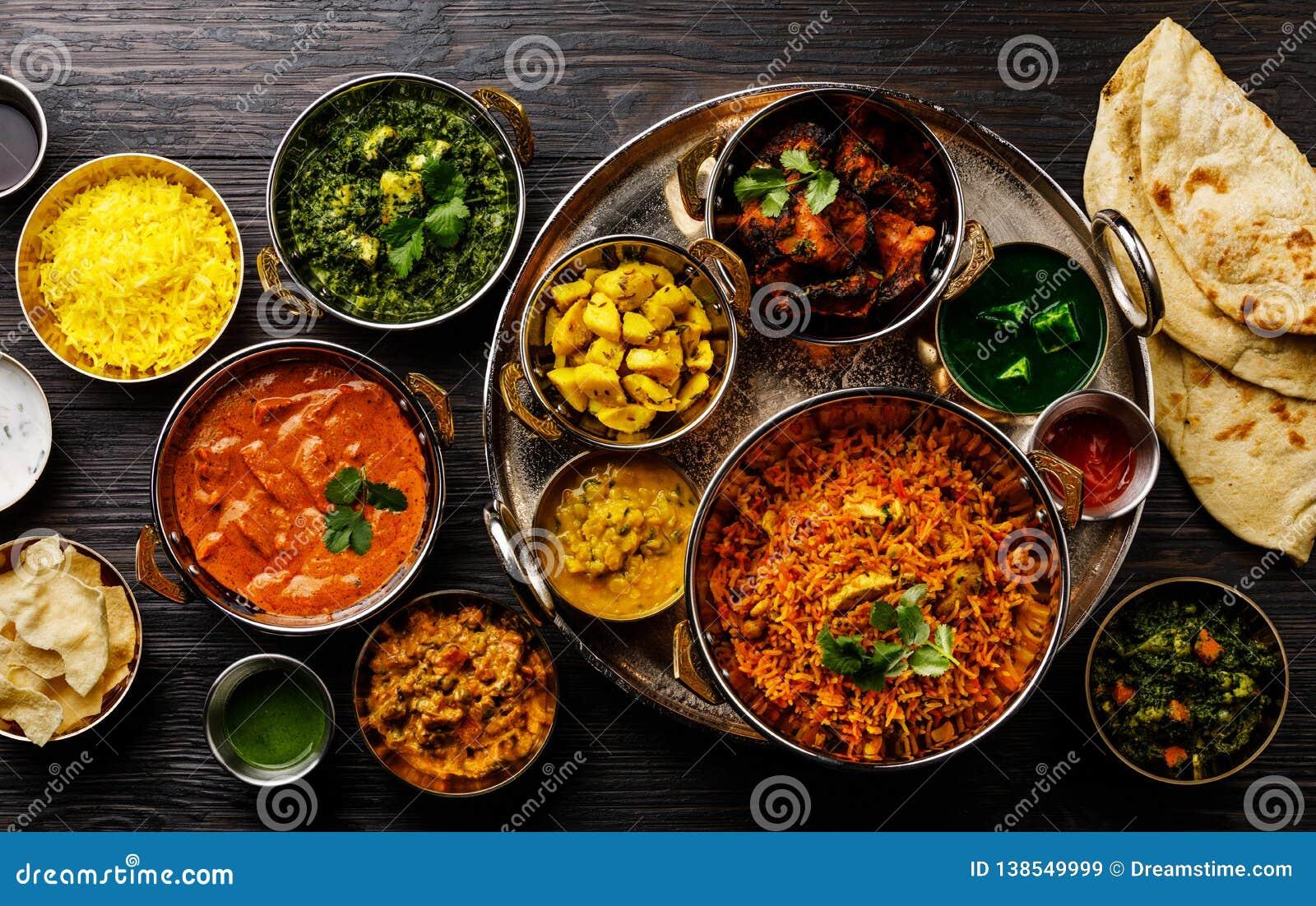 Pollo indio de la mantequilla del curry de la comida, Palak Paneer, Chiken Tikka, Biryani, curry vegetal, Papad, Dal, Palak Sabji