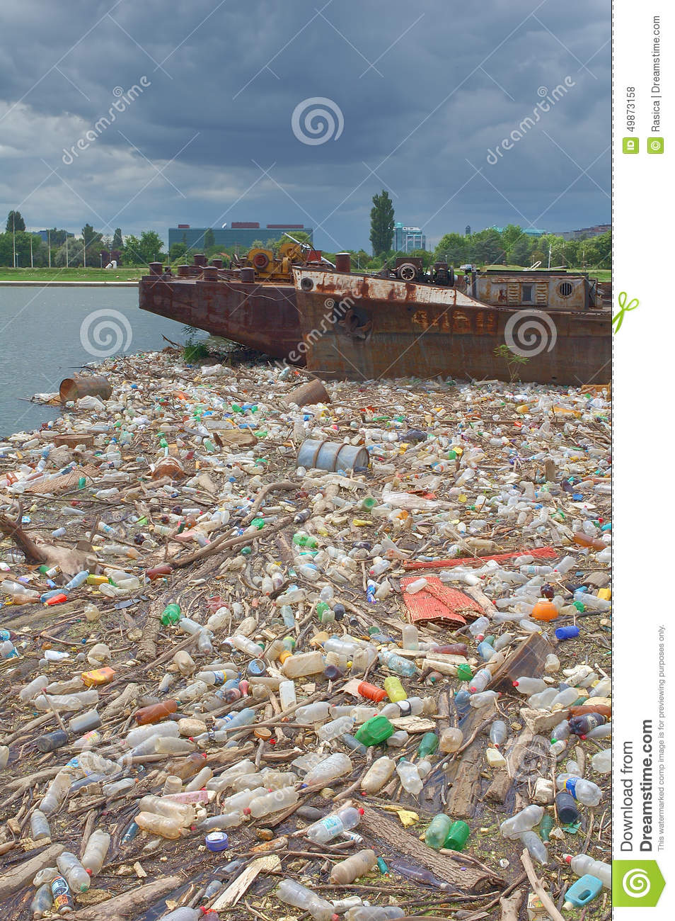 Polluted river bank full of garbage