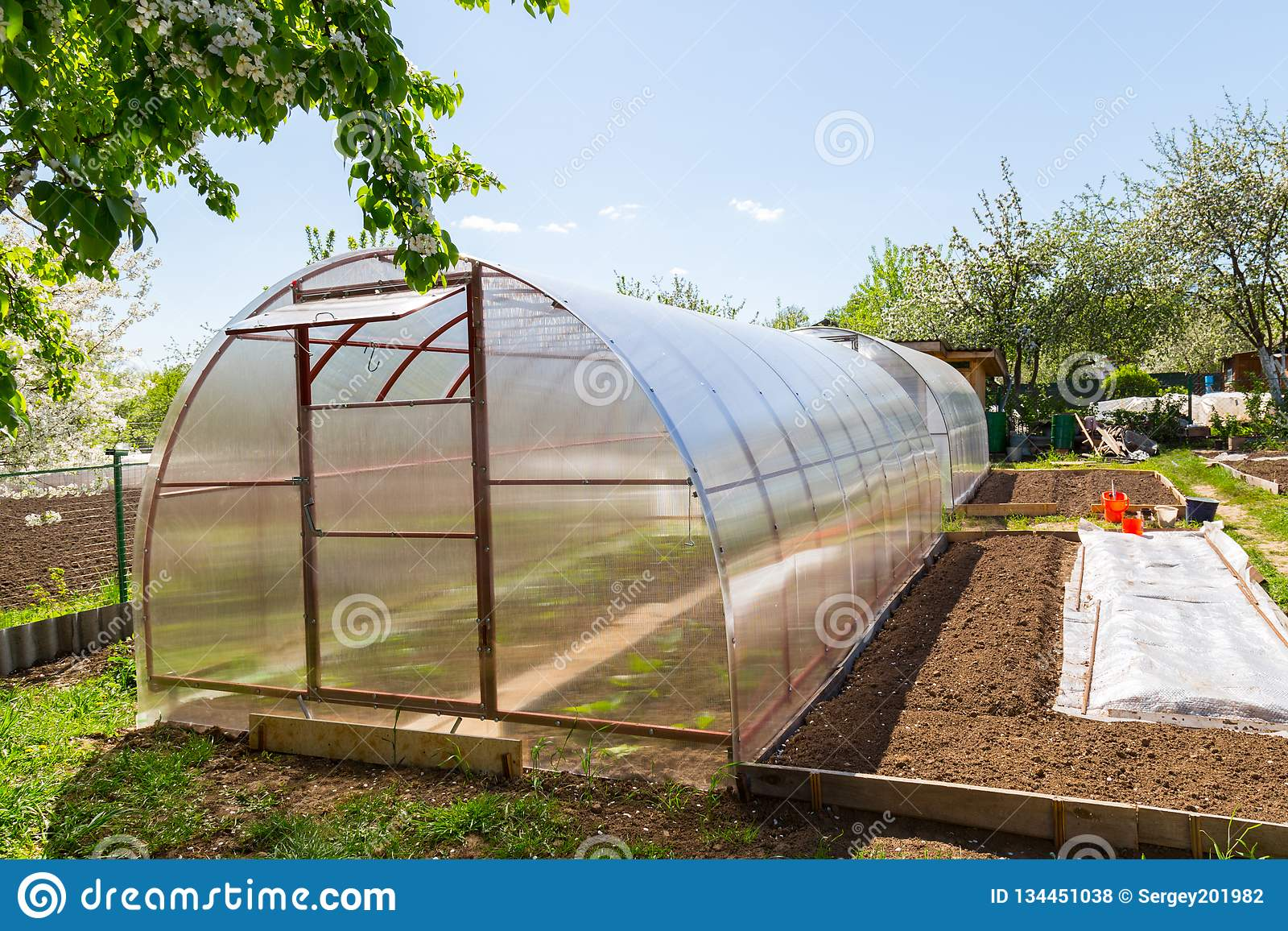 Polycarbonate Greenhouse In The Garden Stock Photo - Image